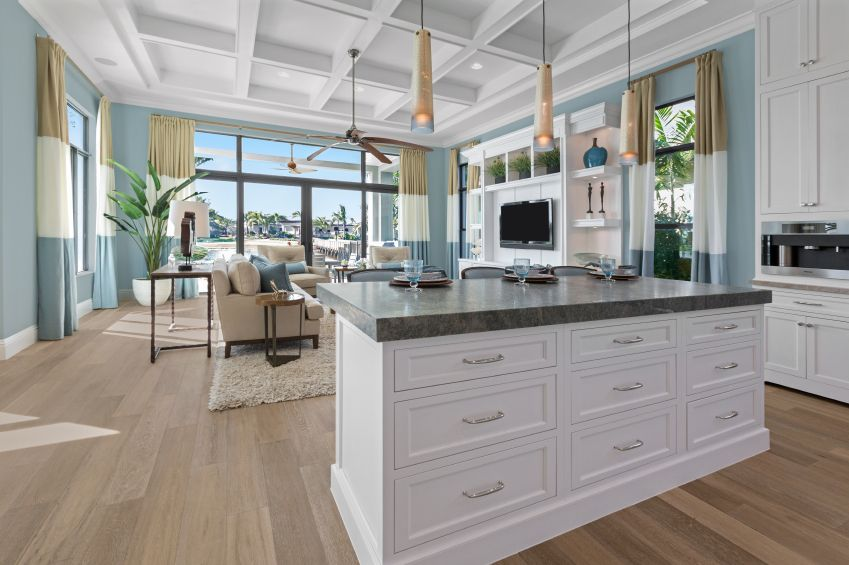 expansive open kitchen features island done in white