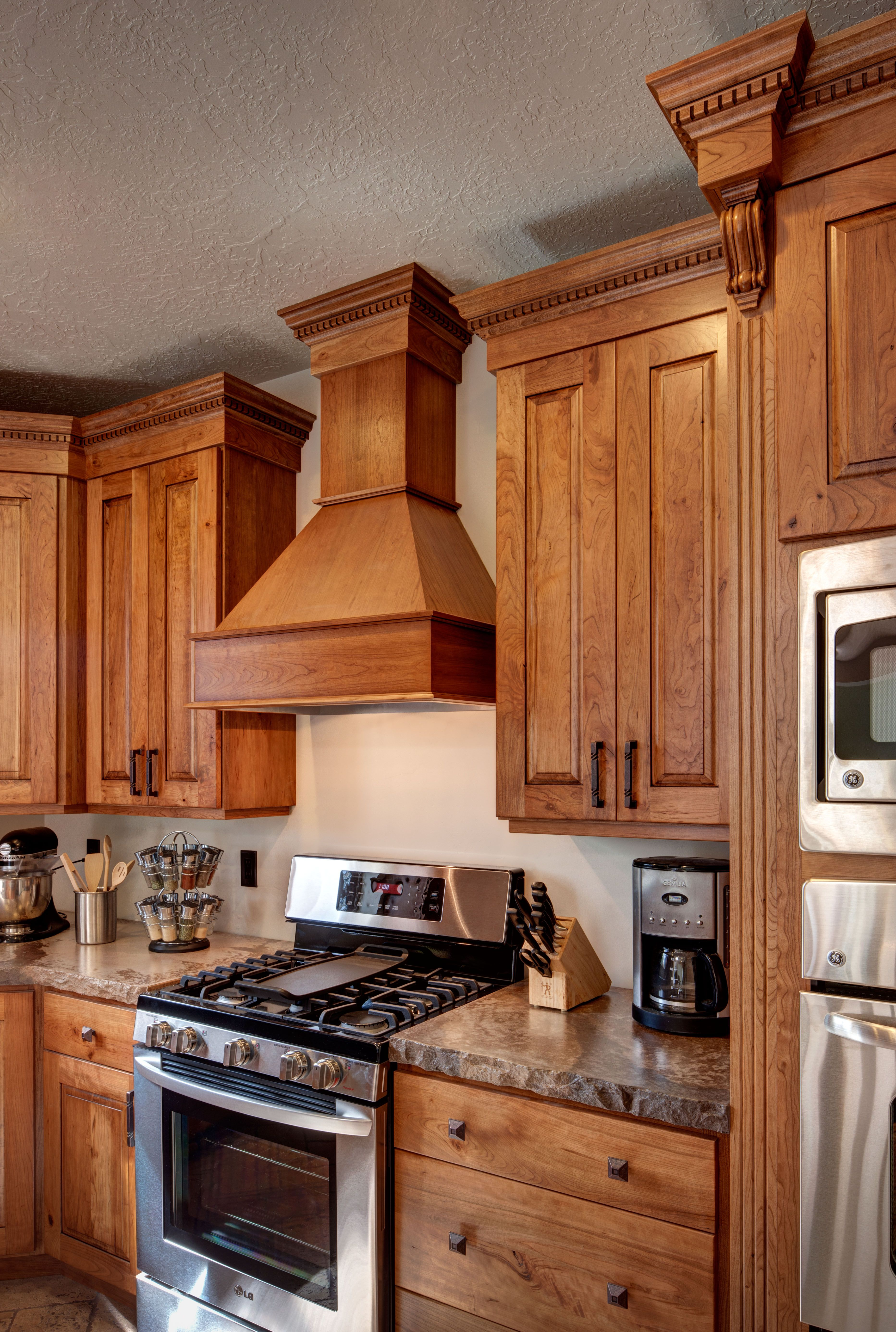 Pin By Crown Cabinets On Knotty Cherry Cabinetry Hickory Kitchen Hickory Kitchen Cabinets Kitchen Cabinets Pictures