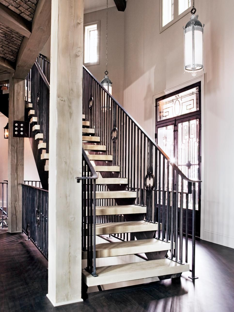 The Wrought Iron Railings Of This Staircase Echo The Decorative