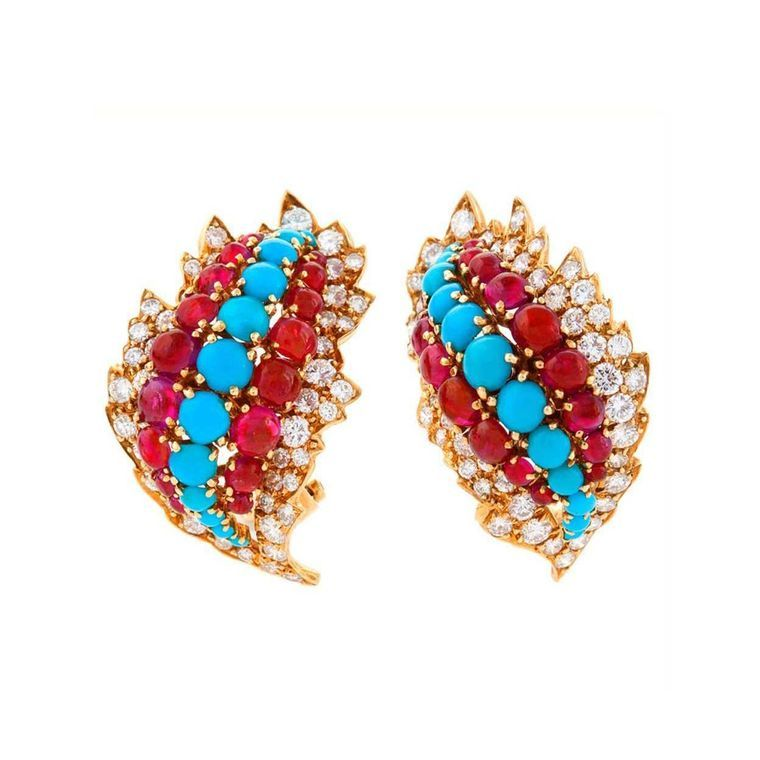 Macklowe Gallery's pair of American mid-20th Century 18ct gold ear clips with diamonds, rubies and turquoise, by David Webb.