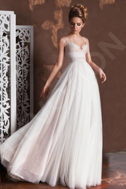 This flawless wedding gown with a hint of Italian style will let all ...