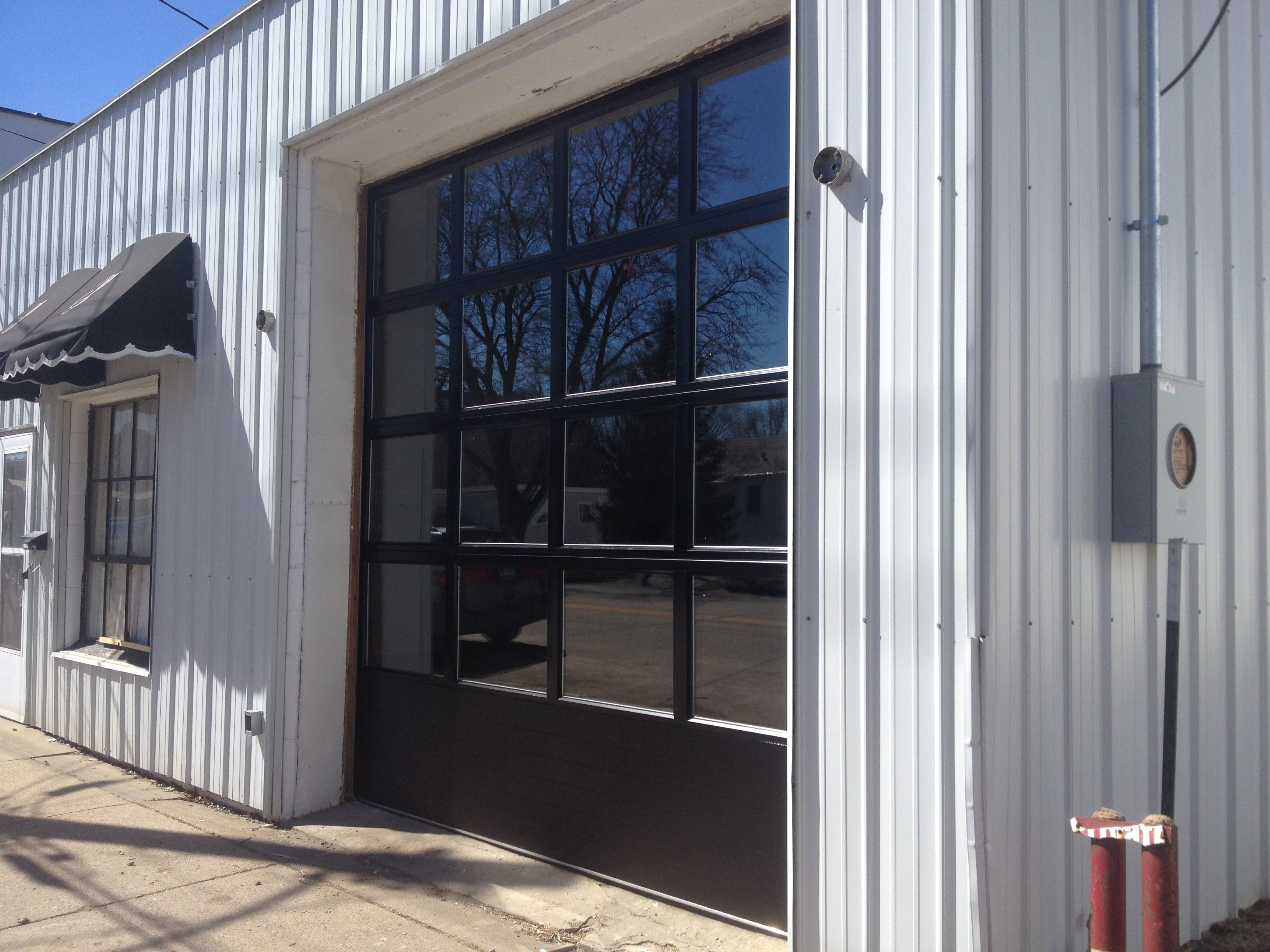 Business Garage Door With Full Glass For Optimal Light Garage Doors Commercial Glass Doors Commercial Garage Doors