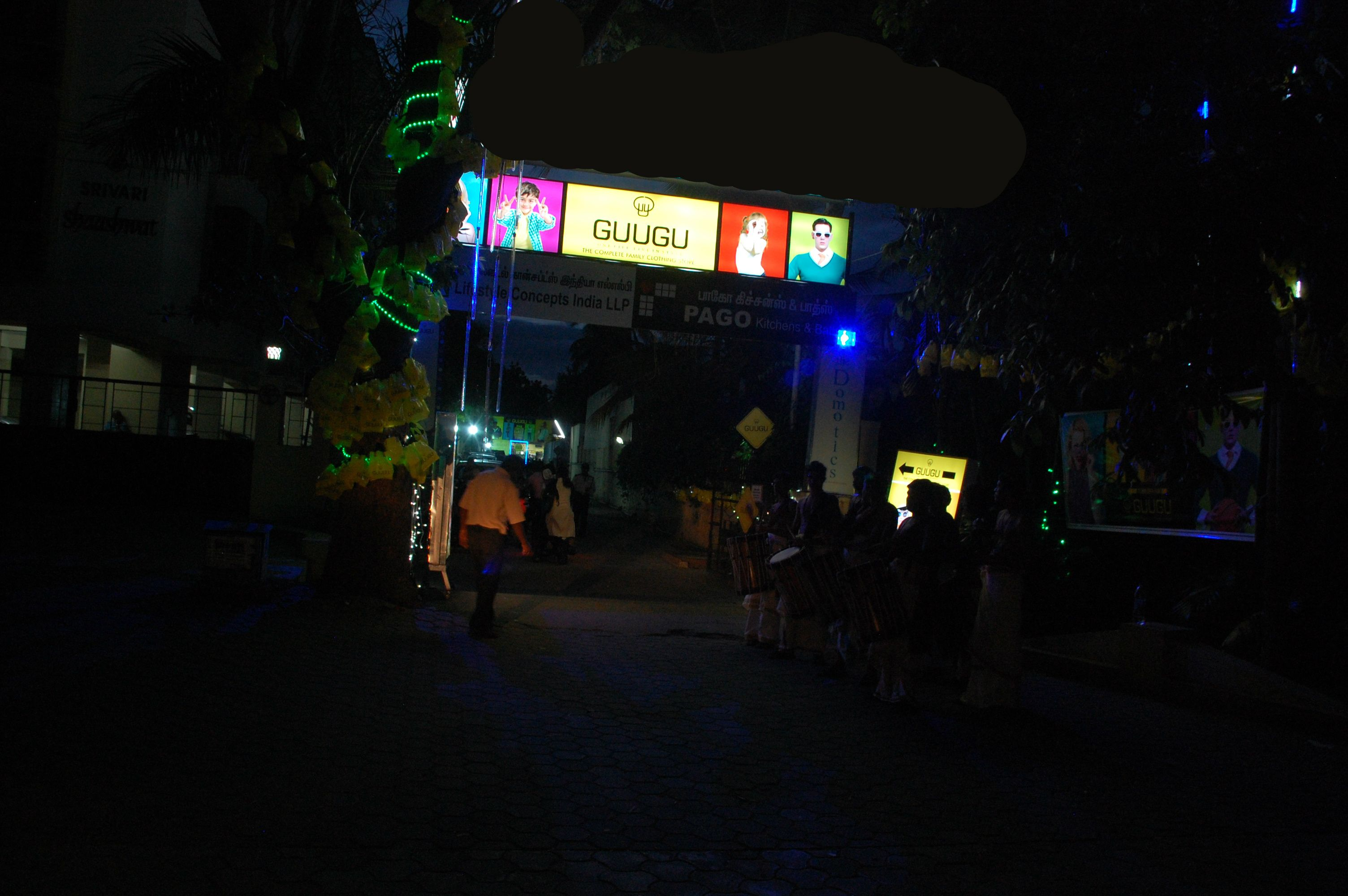 Illuminated store signage at entryway on Race Course Road, Coimbatore