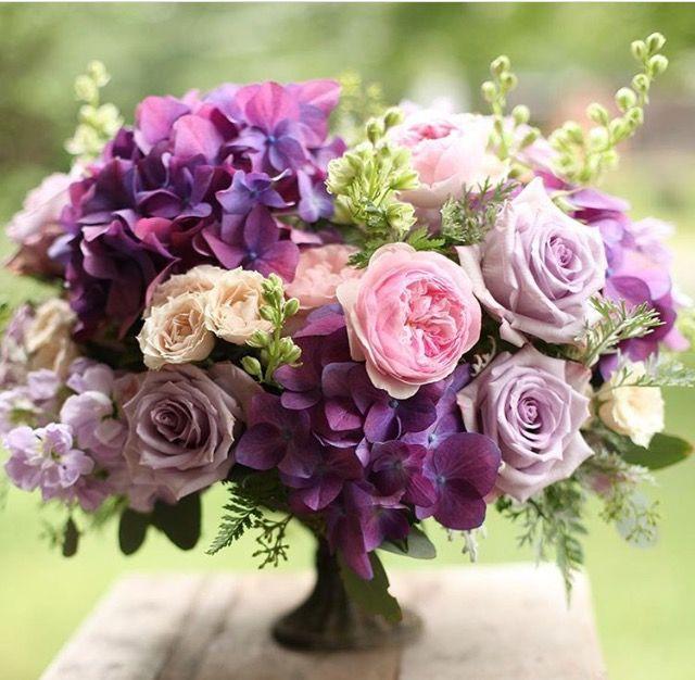 Purple And Pink Centerpiece By Floral Verde Purple Wedding Centerpieces Pink Flower Centerpieces Pink Flower Arrangements