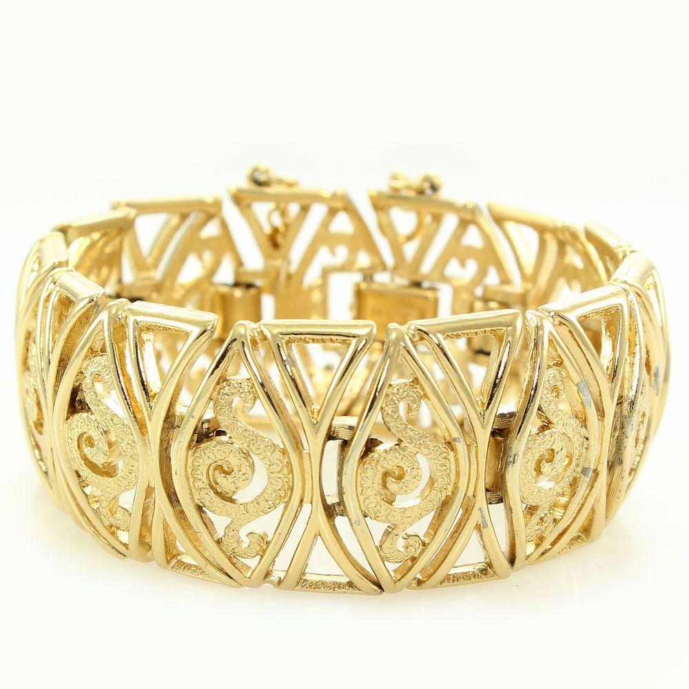 Vintage monet goldtone arabesque link bracelet swirl marquise with