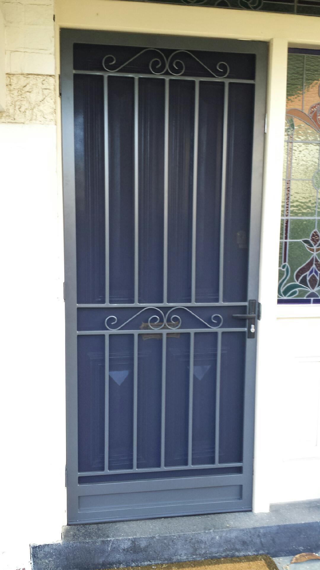 Steel security door with stainless steel mesh installed in ...
