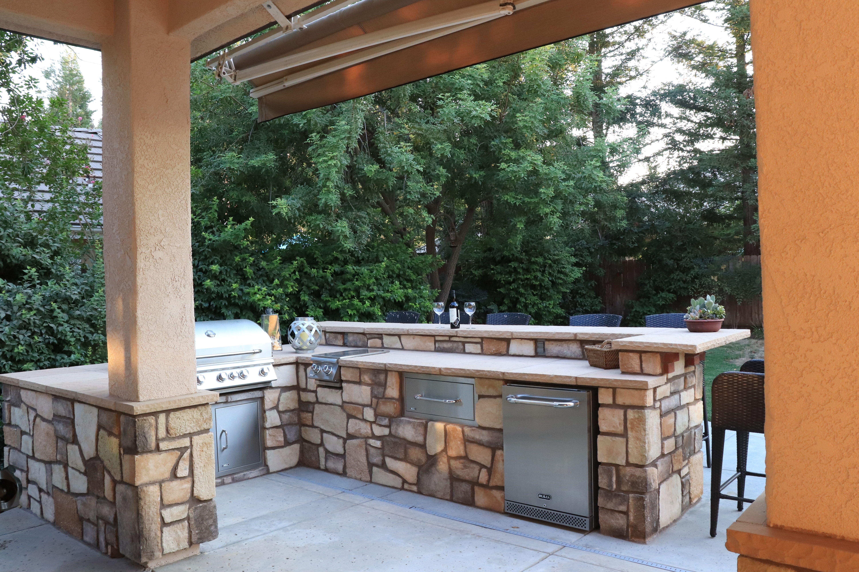 solid masonry stone outdoor kitchen with raised backsplash and bar top viking masonry 559 978 on outdoor kitchen backsplash id=69041