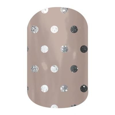 Icy Taupe Polka by Jamberry Nail Wraps. Filled with classic lines and fun polka dots, the Dotted Line collection is perfect to wear with our bolder wraps or wear on their own. Appropriate for any setting, these wraps are an essential part of any nail lover's collection. Lasts up to 2 weeks on fingernails and 4 weeks on toenails.