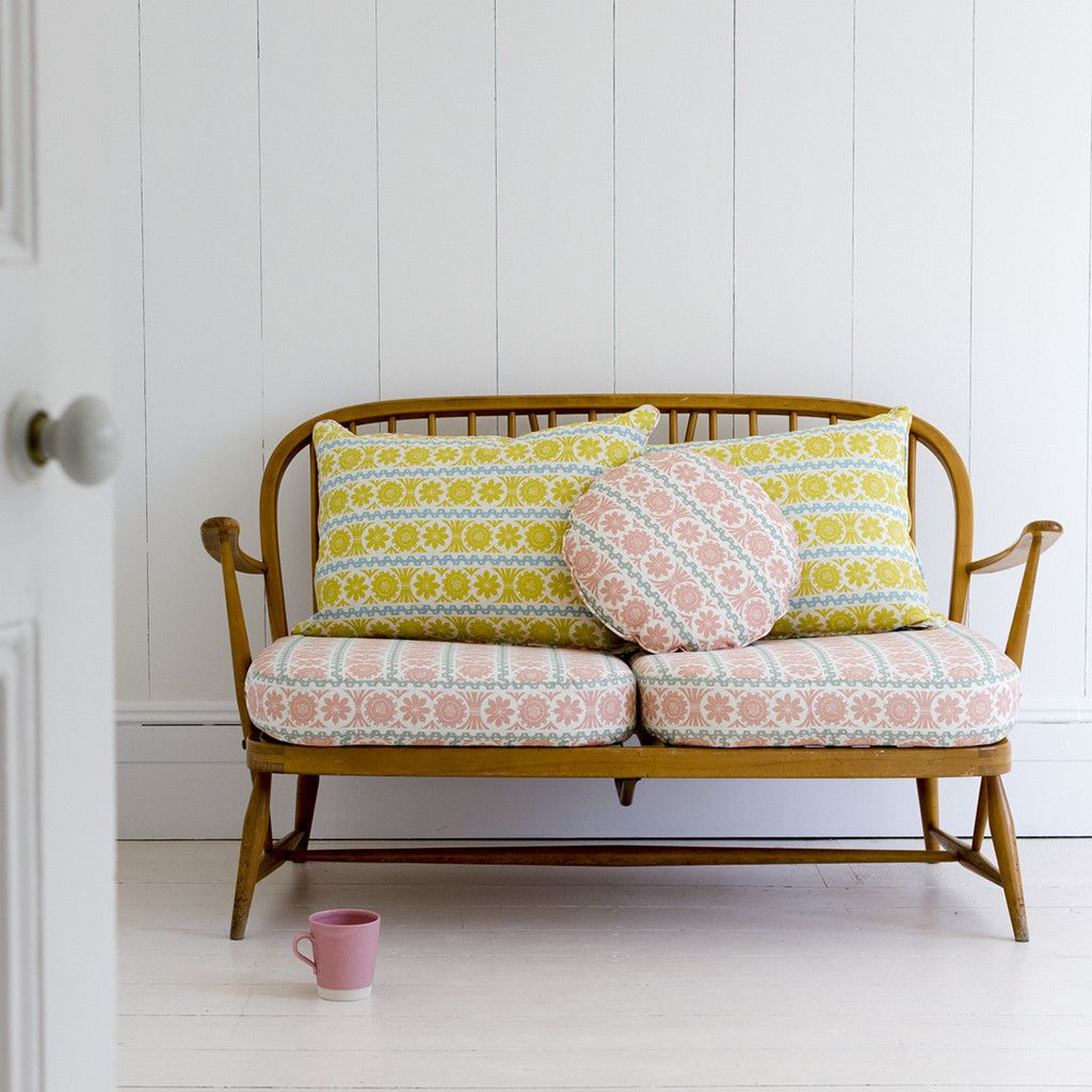 Pink And Yellow Sofa Cushions On A Retro Wooden Sofa St Judes