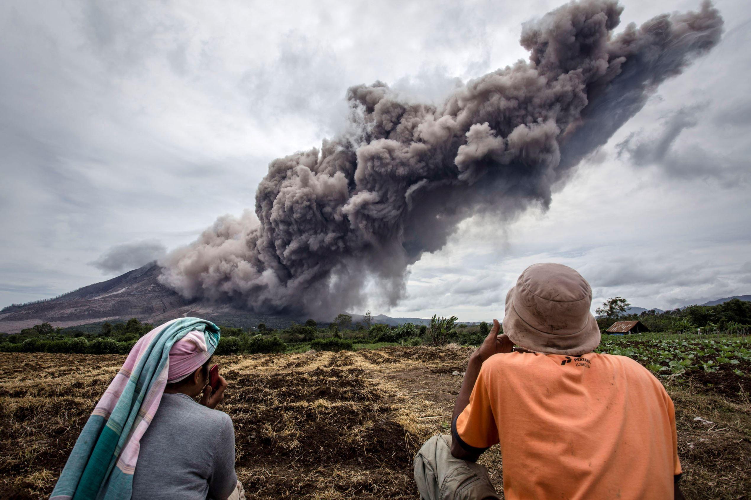 Sumatra, Indonesia Farmers in Tiga Kicat village look on