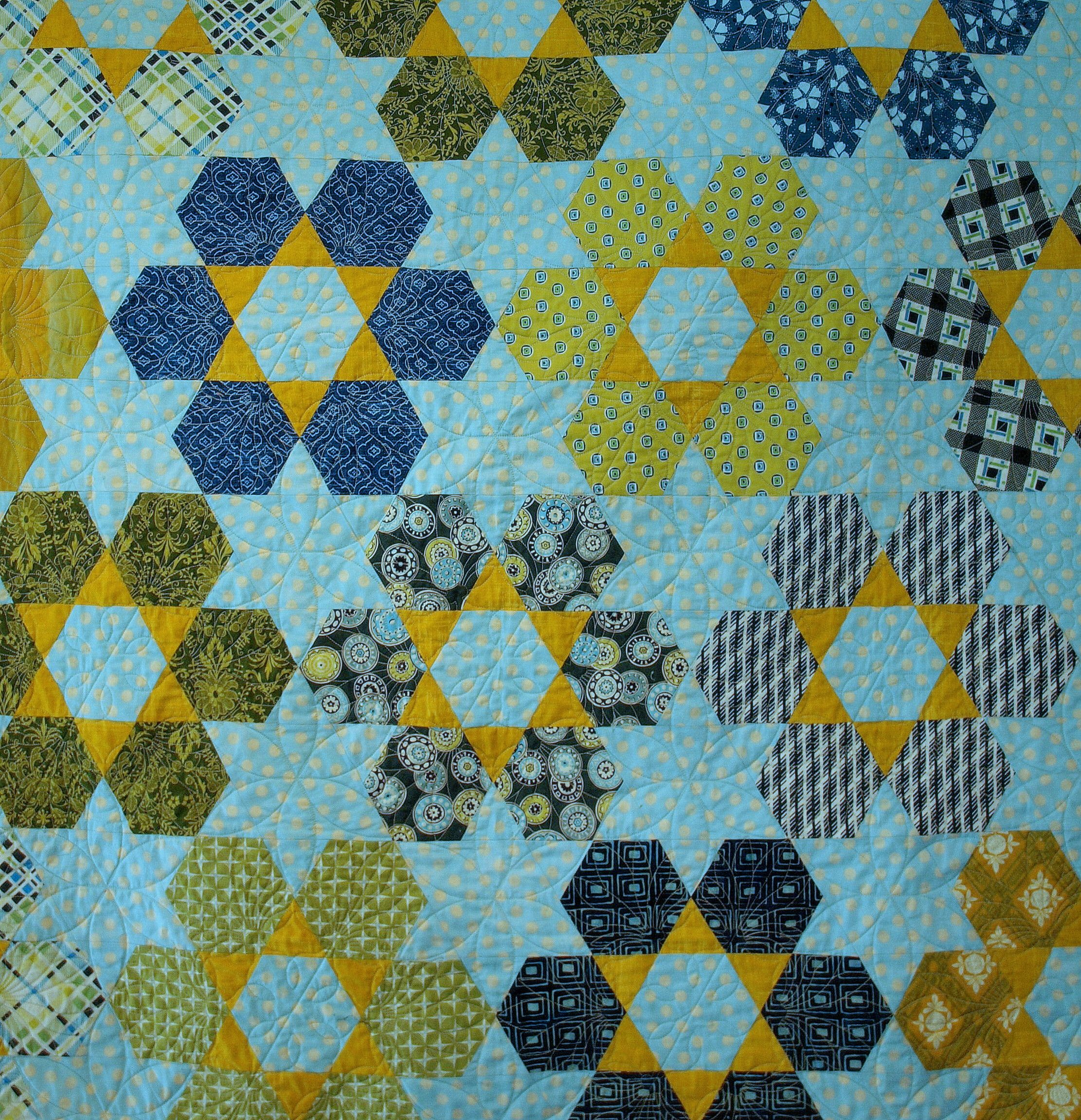 This hexagon quilt with setting triangles is more interesting