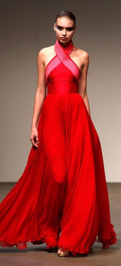 Alex Perry did not disapoint with his trademark floor length dramatic and glamourous gowns in red colour