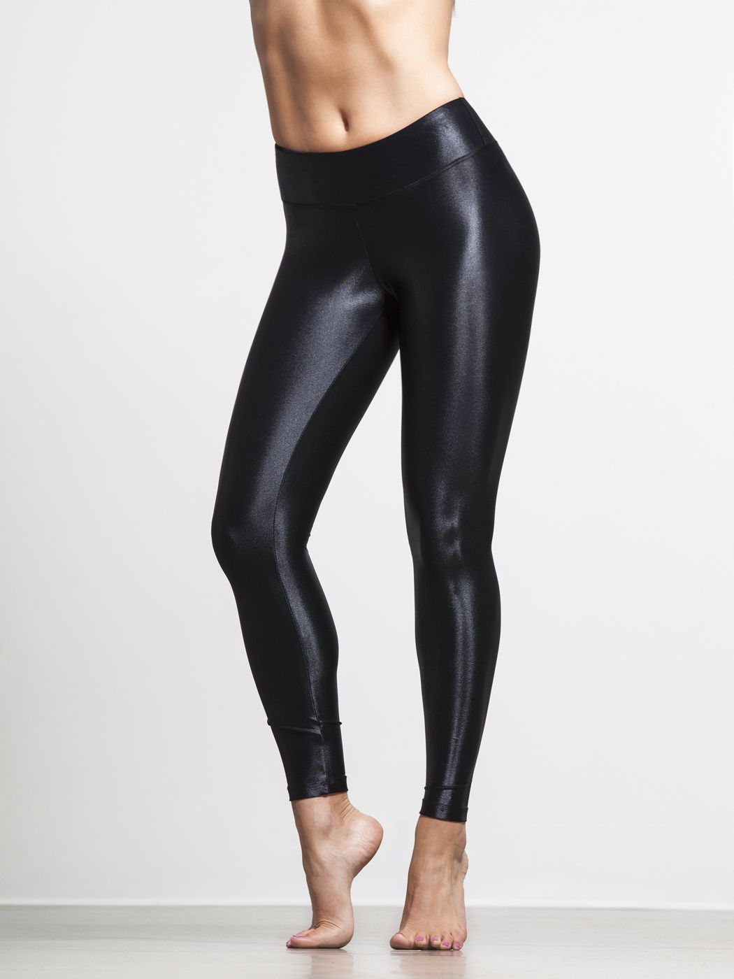 f18e47e56b584d Just because you feel at home on the yoga mat doesn't mean you want a matte  finish. Koral's sexy, shiny leggings give you a 'wet' look that's straight  out ...