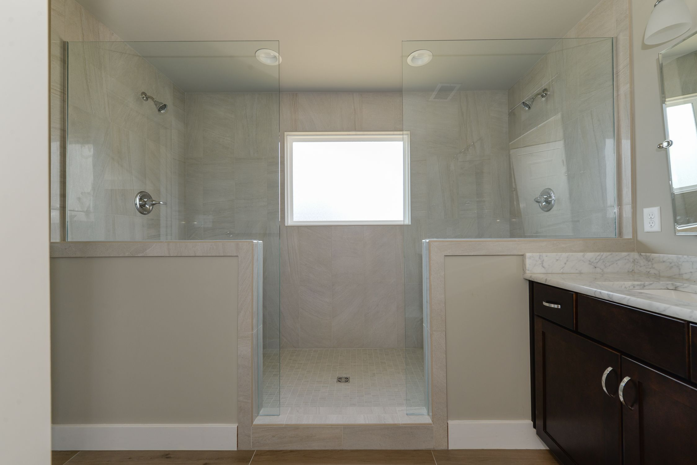Dual shower heads in this large walk-in, tiled master shower in the ...