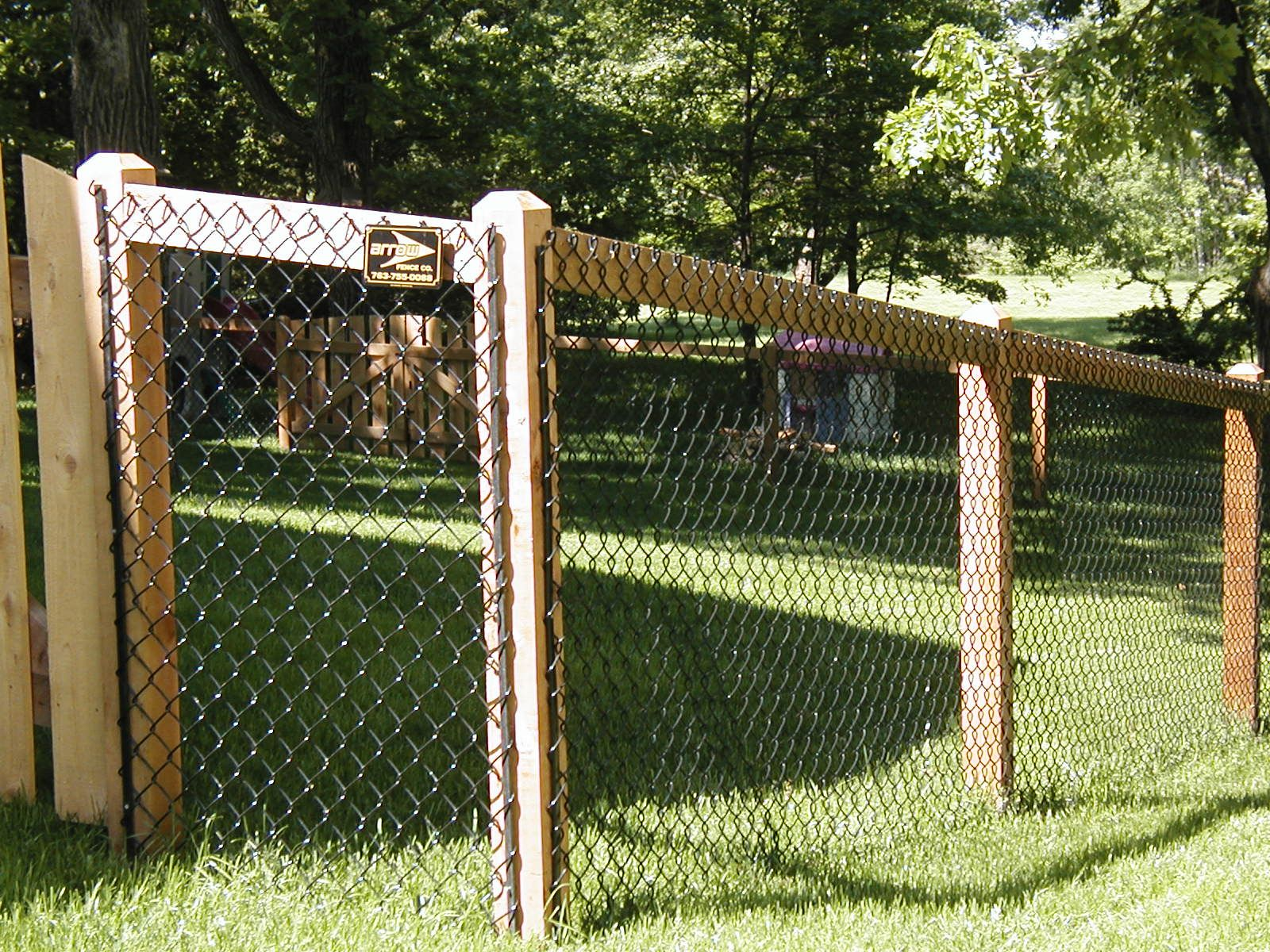 Installing chain link fence with wood posts 36 fence with california chain link fence angies list in the press baanklon Images
