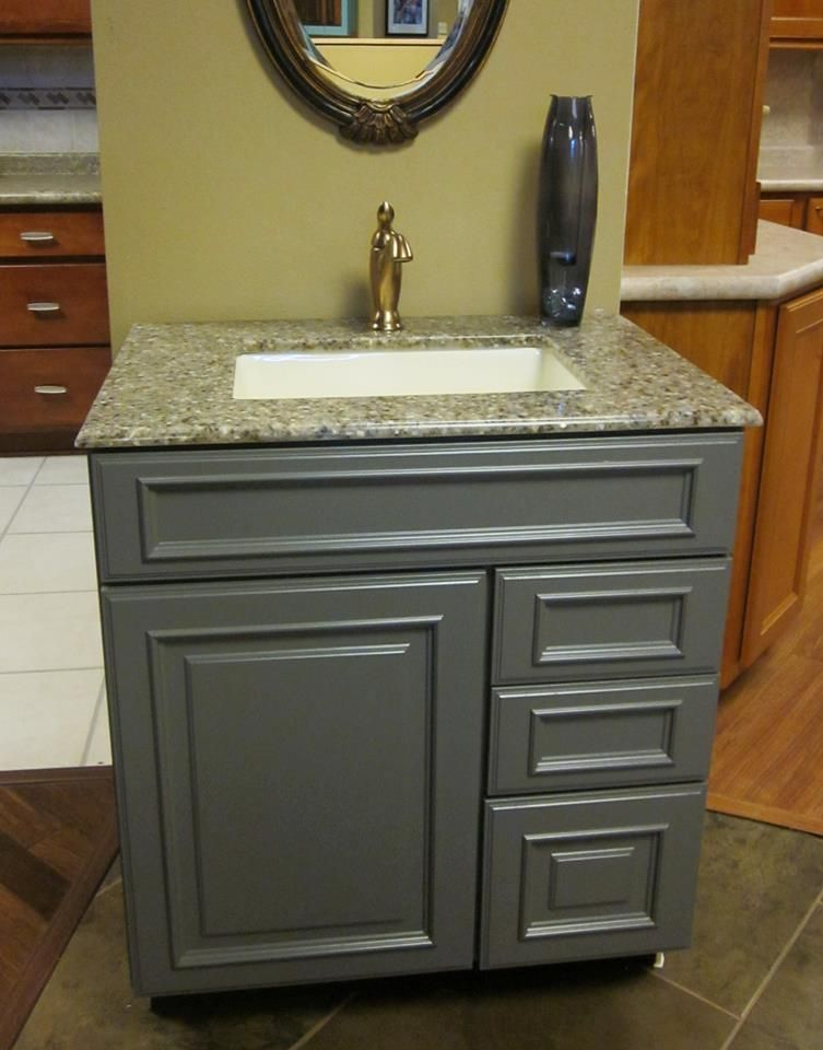 This vanity features kraftmaid cabinetry the door style for Bathroom cabinets kraftmaid