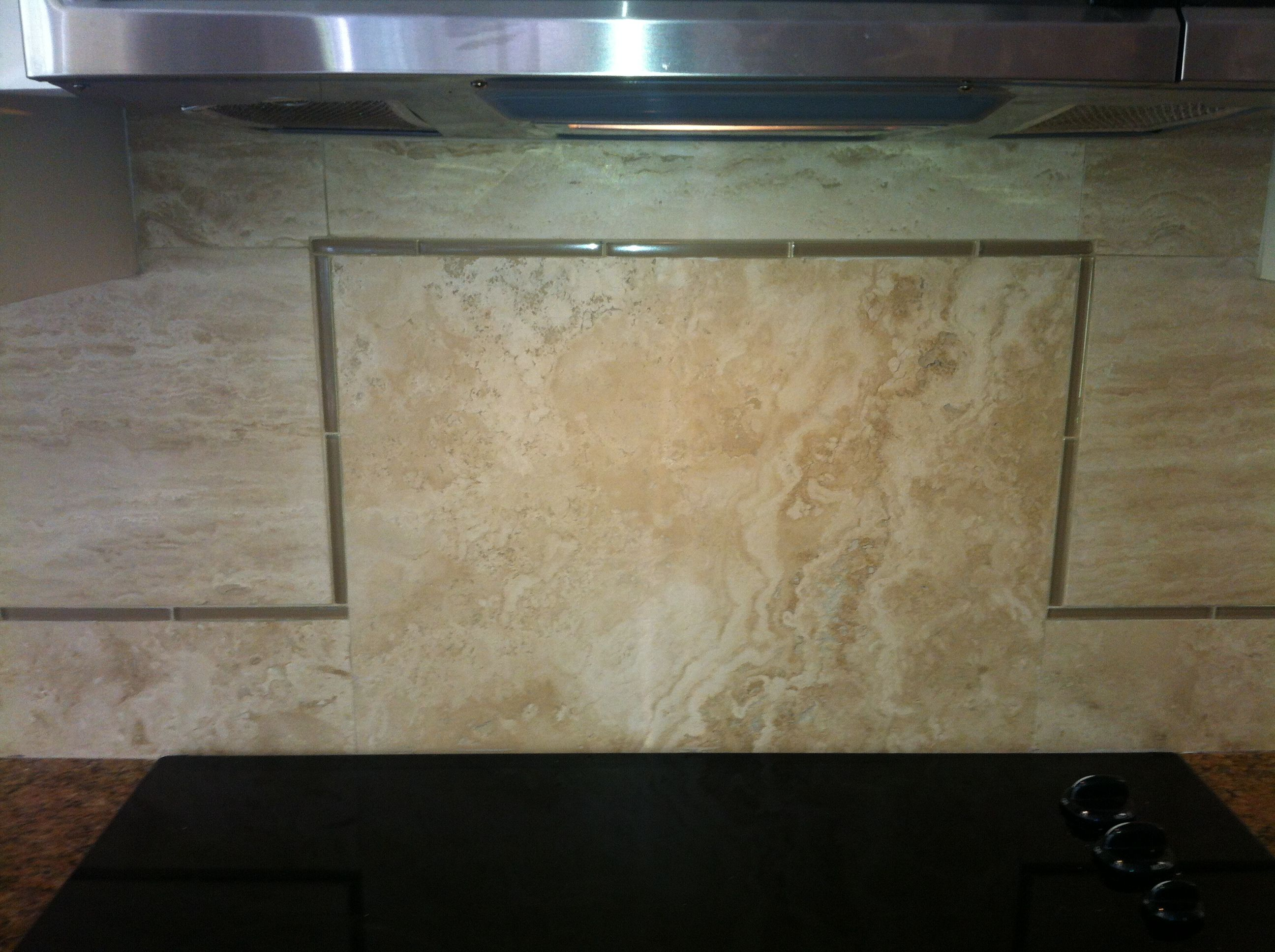 our new backsplash mixture of vein cut & cross cut Travertine with glass bead tile