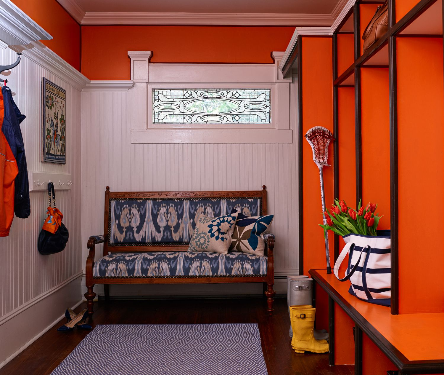 Hermes orange mudroom with vintage bench covered in ikat fabric by k k interior design for Bergen county interior designers