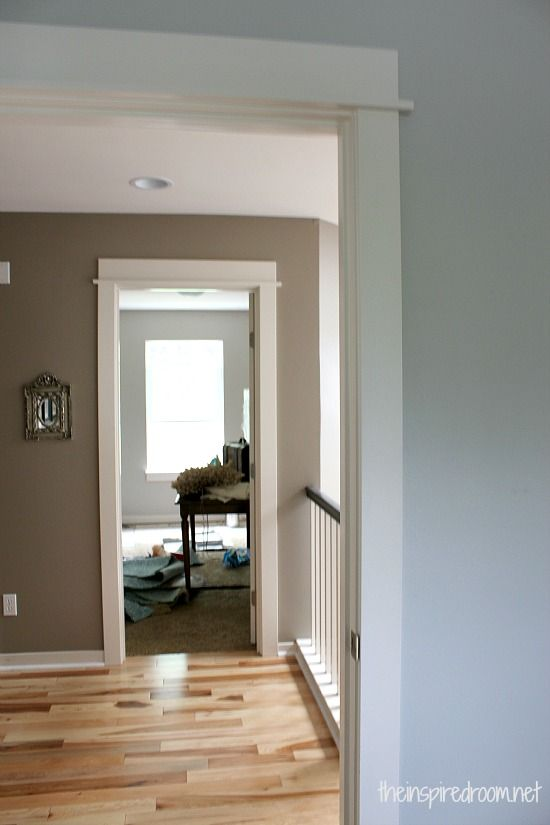 Improving the visual flow between rooms dark paint for Hall paint colors images