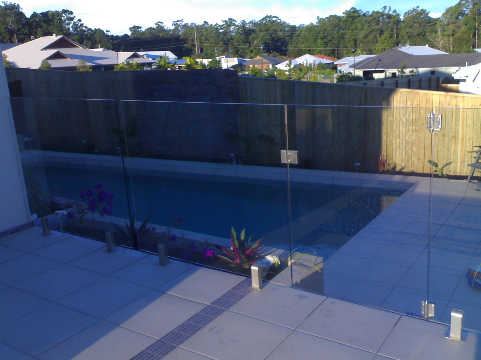 Glass Pool Fence On Sandstone Retaining Wall Google Search Glass Pool Fencing Pool Landscaping Glass Pool