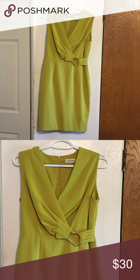 Elegant like new designer dress Fitted, figure-flattering CK sheath with lovely gold accent at waist. The color is unique and really shows off your tan. Calvin Klein Dresses Midi