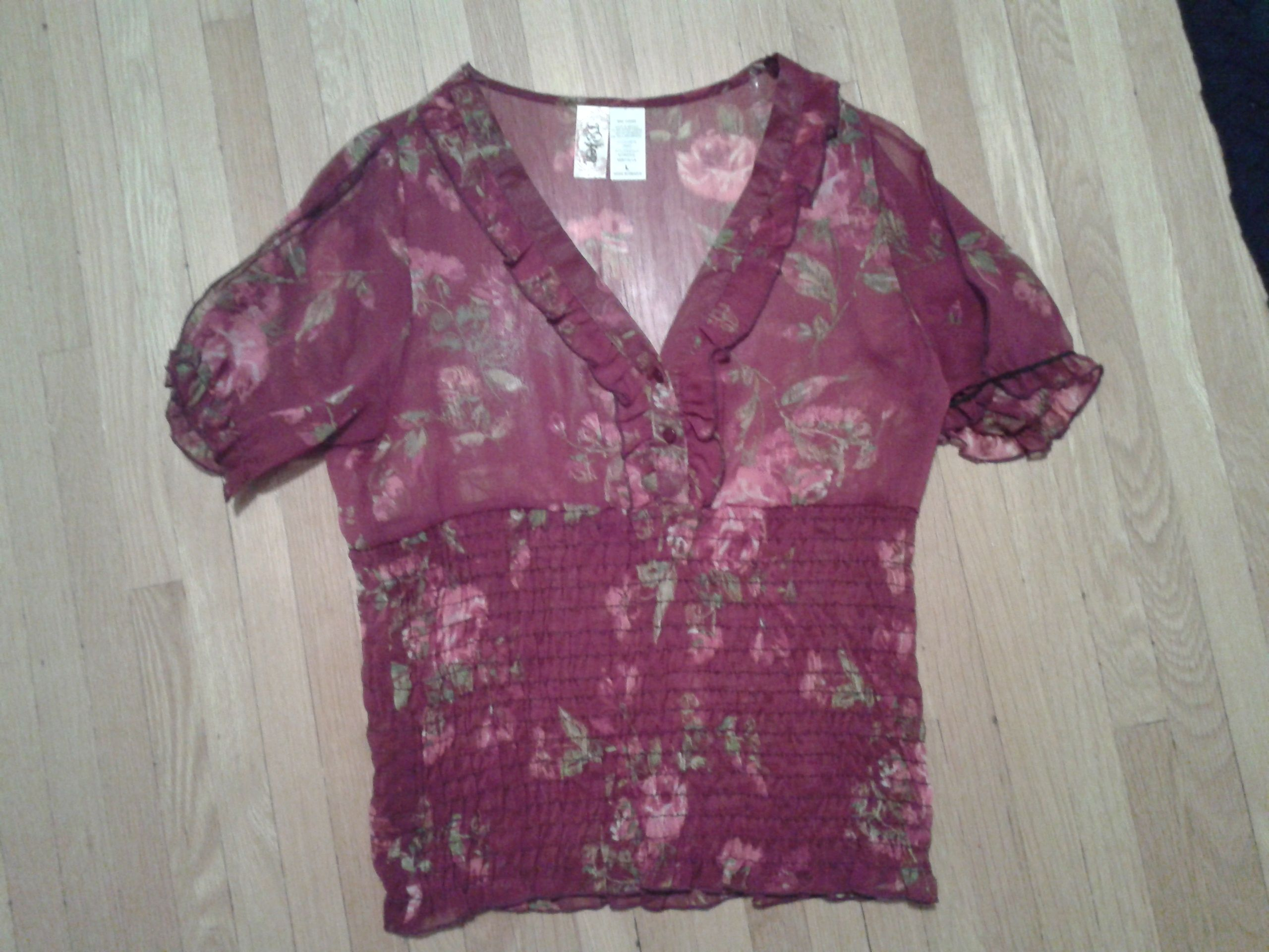 floral shirt in Tidyingup's Garage Sale Helena, MT for $5.00. Sheer floral shirt. size L. Only worn once.