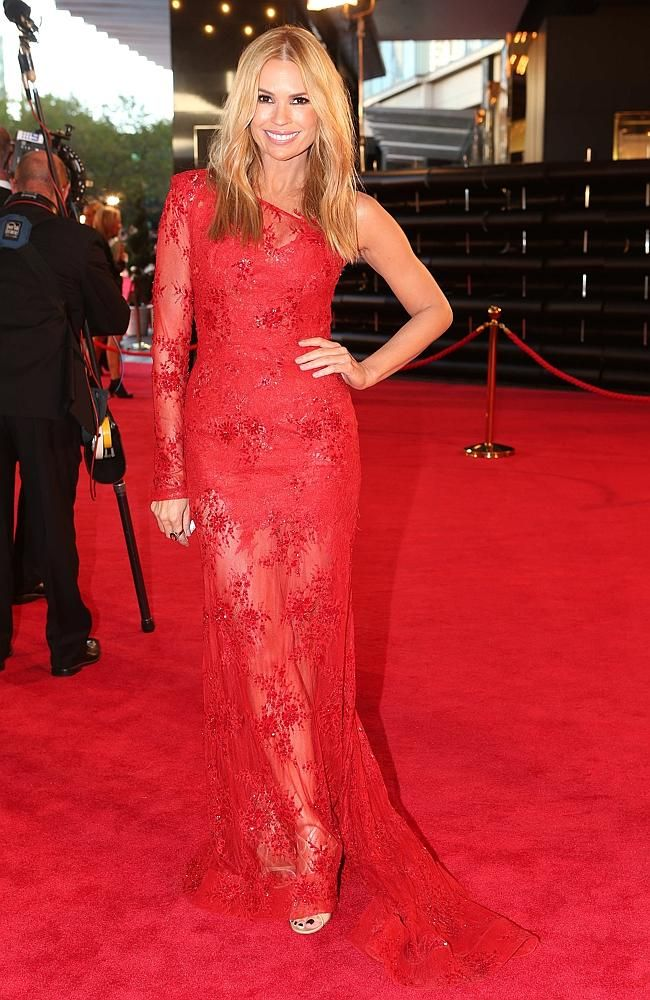 Sonia Kruger wears a stunning one-shoulder red lace gown. #Logies2014  #fashion