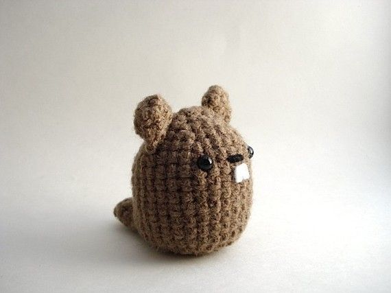 I think this groundhog looks more like a beaver, but it's cute anyways.  Found in moonscreation's etsy shop.