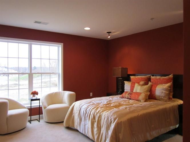 a deep burnished red makes the master bedroom at our deer ...