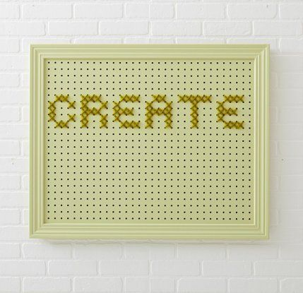 Cross-stitch a large design with yarn on a pegboard.