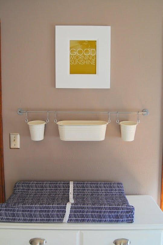 IKEA fintorp hanging over baby changing table in nursery