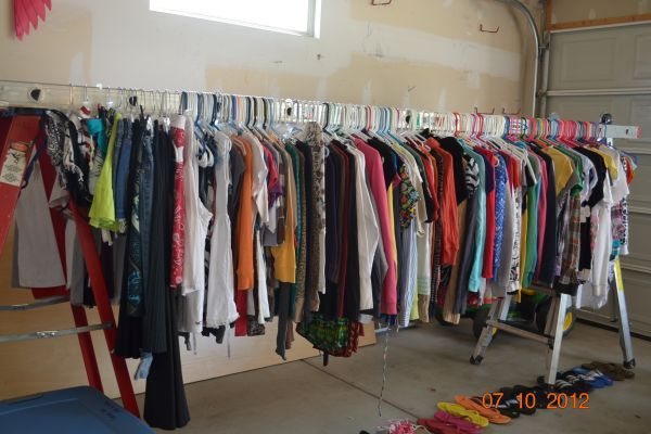 How To Hang Clothes For Garage Sale Ladders Yard Sale Clothes Rack Garage Sale Clothes Hang Clothes Garage Sale