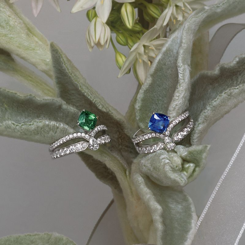 """As sparkling and delightful as a promise, the elegance of these jewellery creations is an ode to femininity: Joséphine """"Eclat Floral"""" rings in platinum, paved with diamonds and set with a cushion-cut emerald of 0.90 carat and a cushion-cut sapphire of 1.37 carats."""