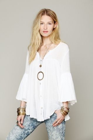 Gauzy cotton tiered tunic top with buttonfront opening. Ruffled bell-sleeves that are 3/4-length. Subtle babydoll shape. Special Note: This tunic was originally offered as a One Size Fits All but is now offered in two sizes XS/S and M/L. $99.95 by Free People