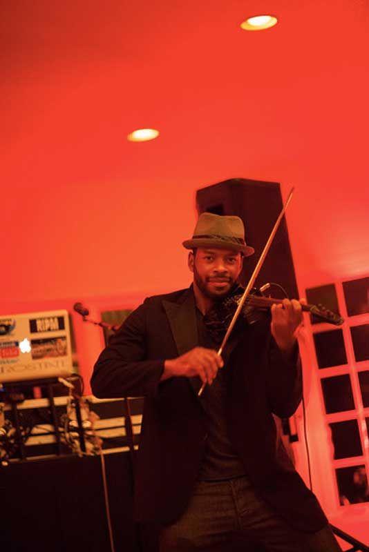 Maestro Hughes Plays Violin Along Side Djs For A Contemporary Twist