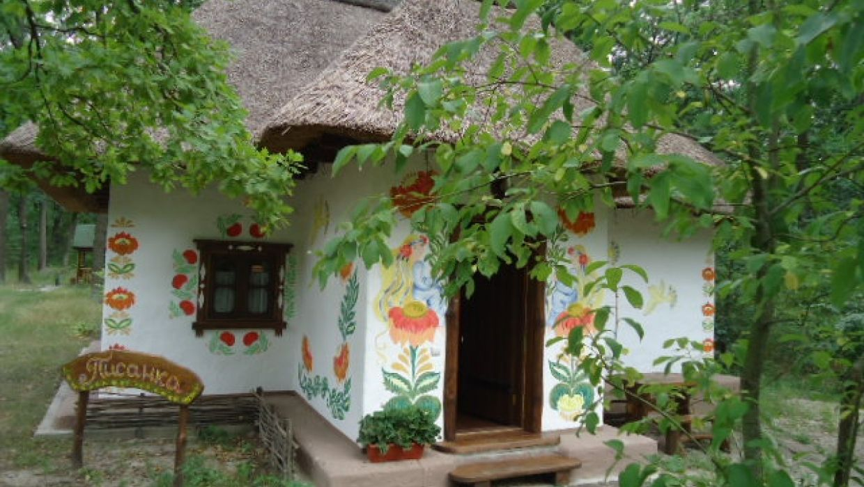 Old Ukrainian House Under Straw Roof With Hand Painted