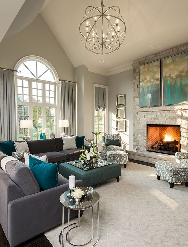 Living Room Decor   Its Hard To Say What Came First; Were The Two Paintings  Hung Above The Stonework Fireplace Inspired By The Turquoise And Charcoal  Gray ...