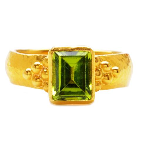 Gurhan Emerald-Cut Peridot Ring in 24k Yellow Gold. This regal cocktail ring features an emerald-cut, apple green peridot gem surrounded by pure 24k yellow gold and handcrafted beading.