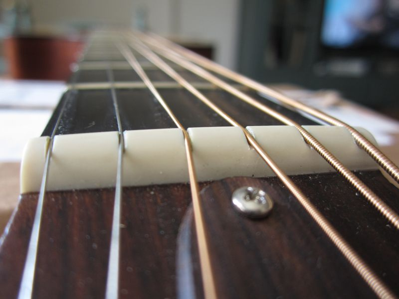 How to Fix a Guitar Nut With Baking Soda and Super Glue