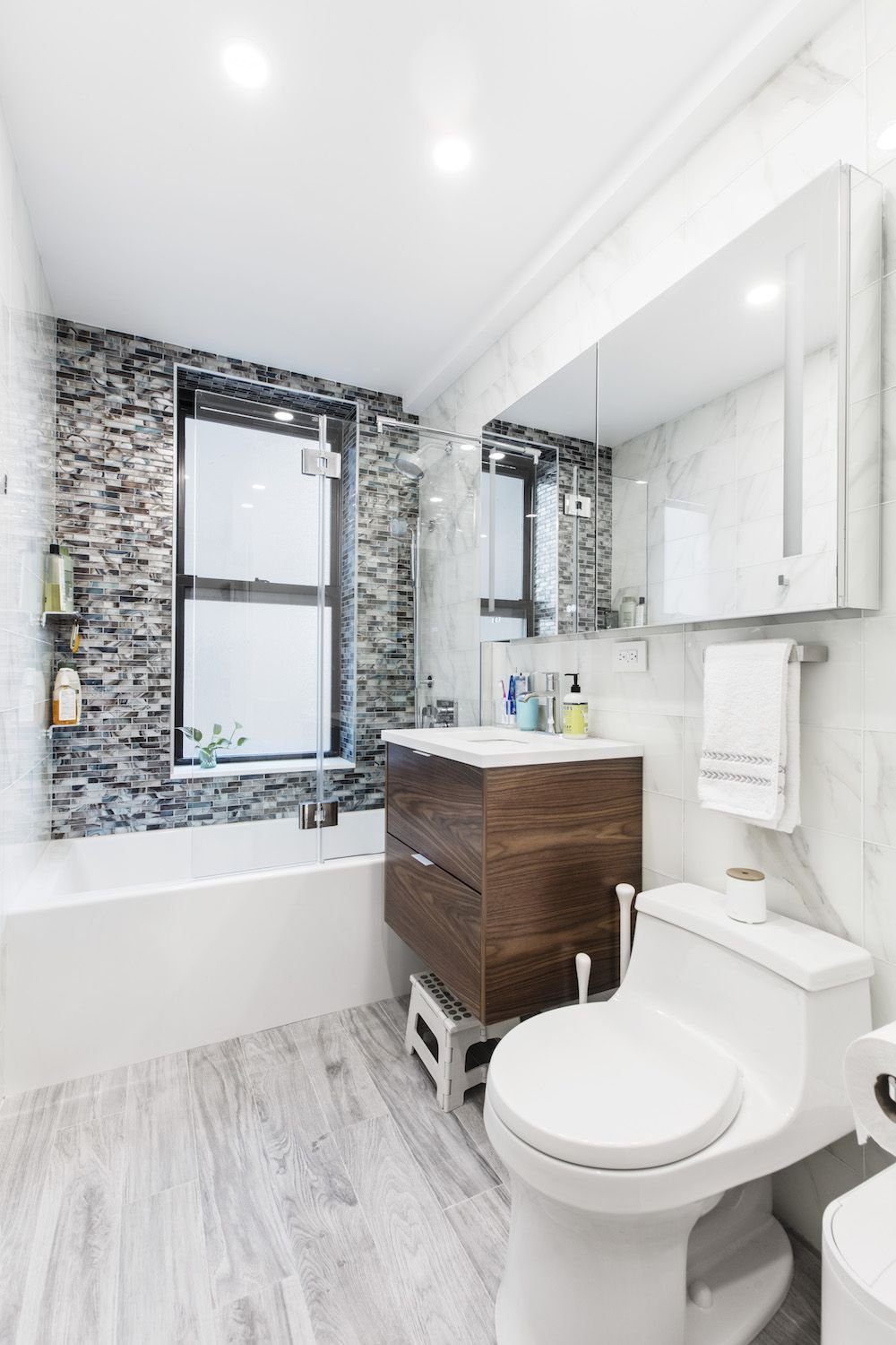 Renovators Return To Complete Their Bathroom Renovation In Queens White Subway Tile Shower Glass Bathroom Bathroom Renovation