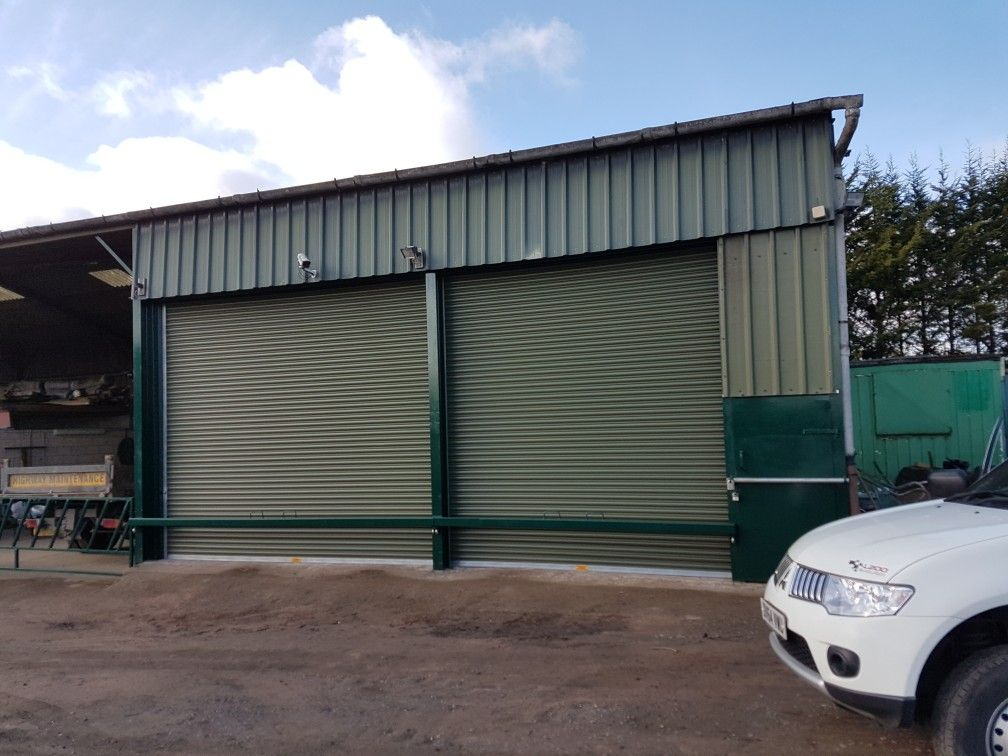Two Industrial Olive Green Roller Shutter Doors Fitted To A