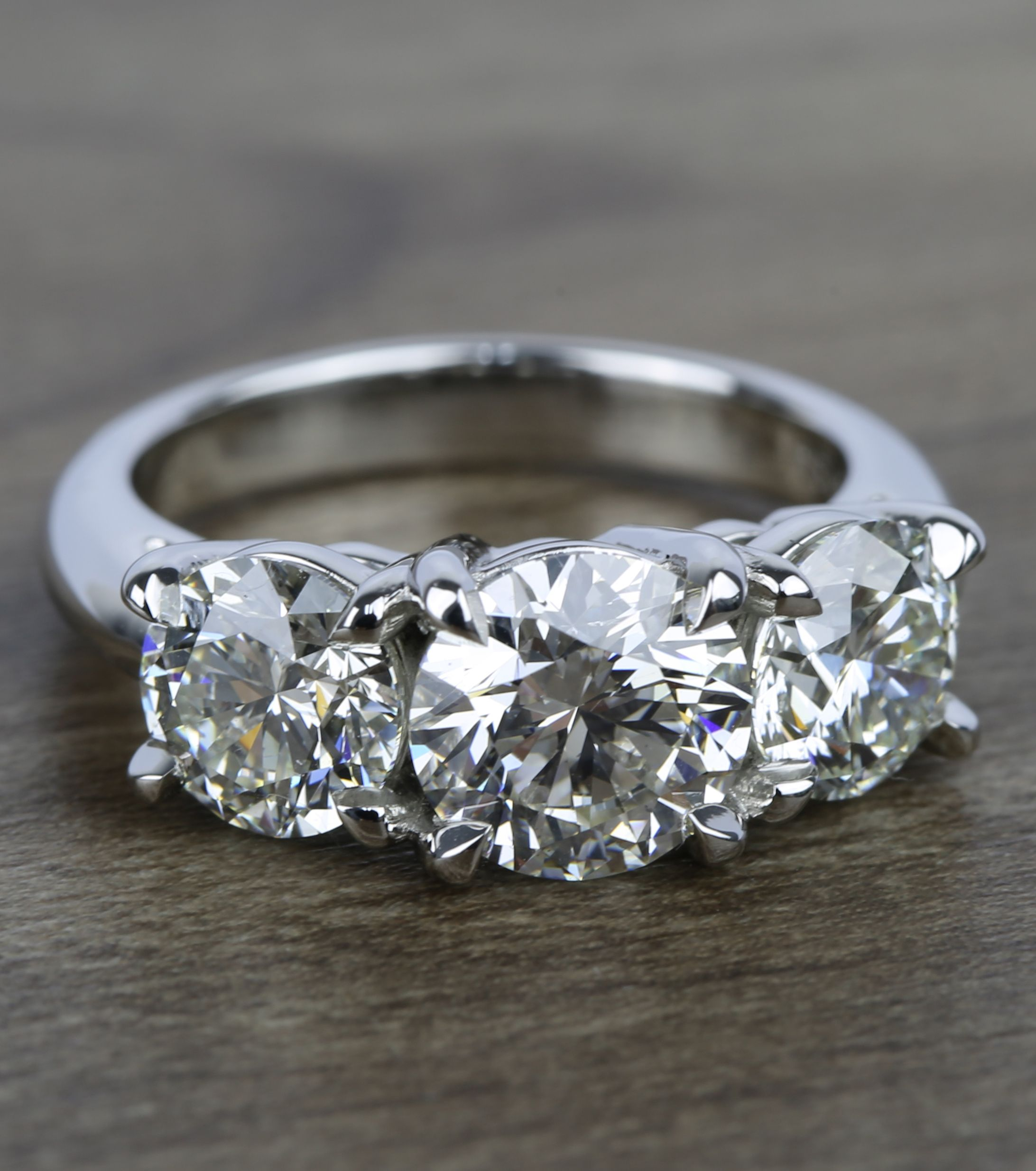 This Three Stone Platinum Engagement Ring Boasts A 2 Carat Center Diamond And Incorporates