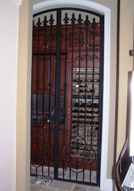 Custom wrought iron door grilles designed and built by Grill main door design
