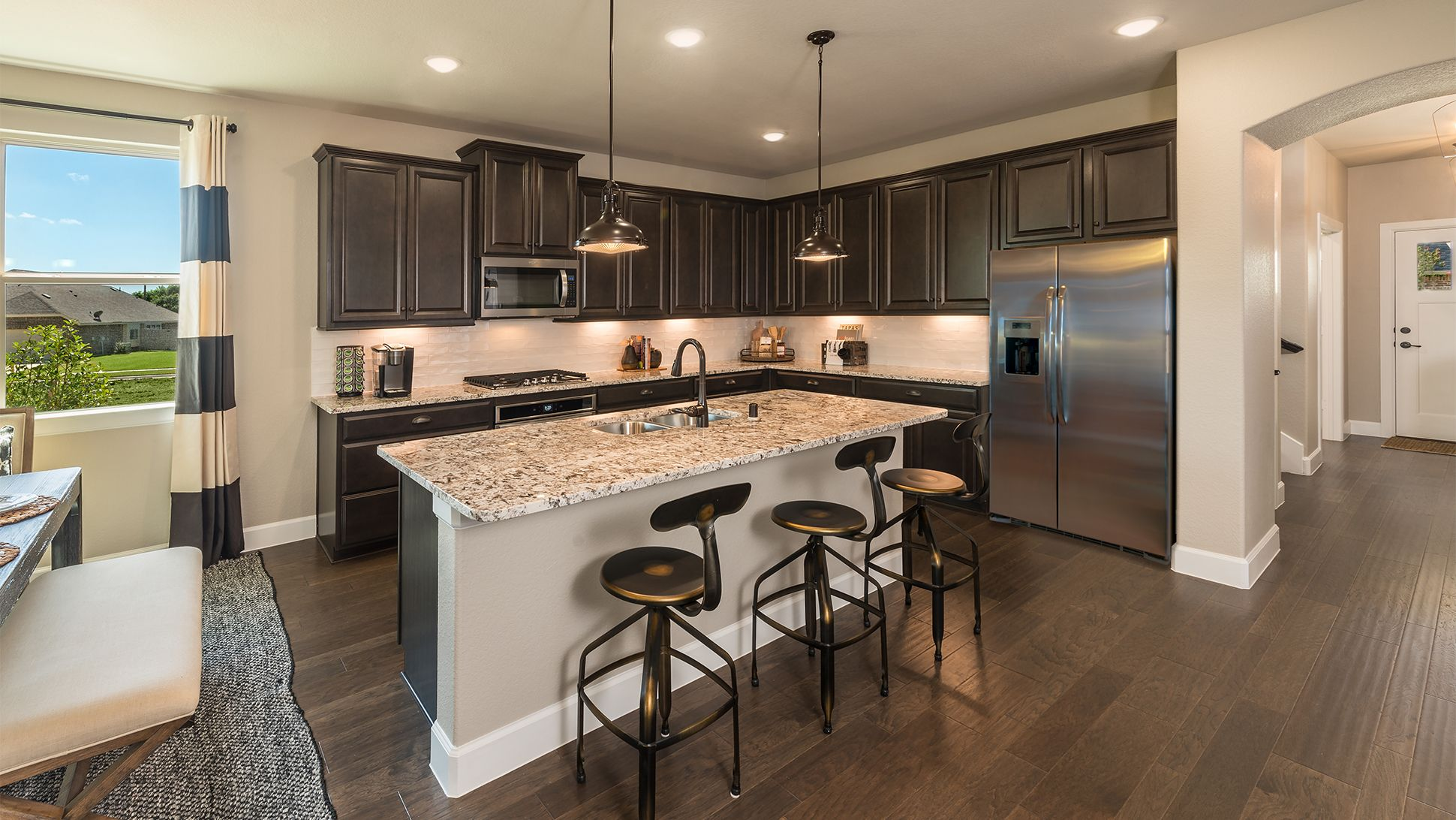 An Open Concept Kitchen With A Large Island Is The Perfect Place For Families To Gather And Make Preci Open Concept Kitchen Energy Efficient Homes House Prices