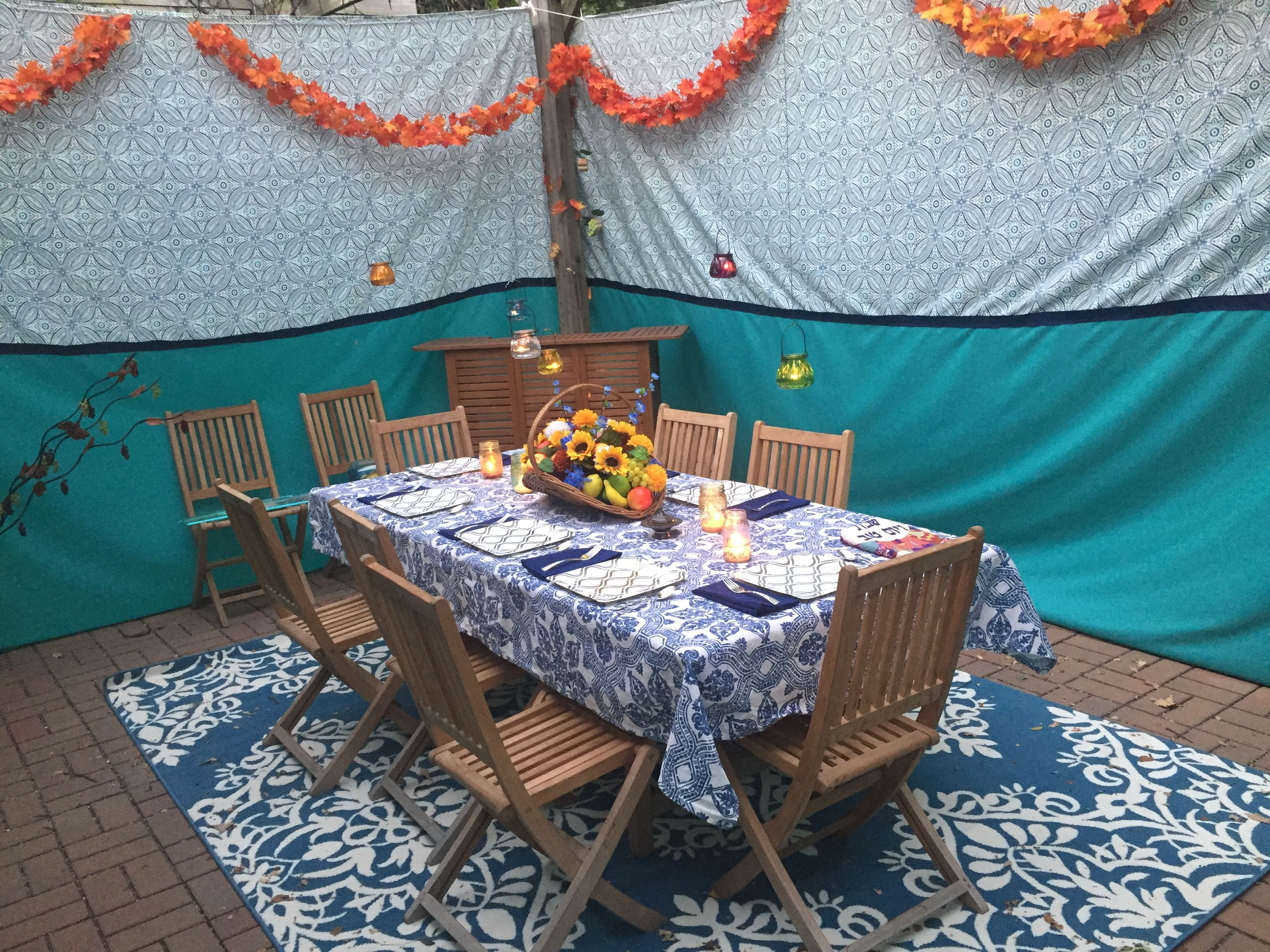 Moroccan inspired succah with outdoor rug hanging tea light