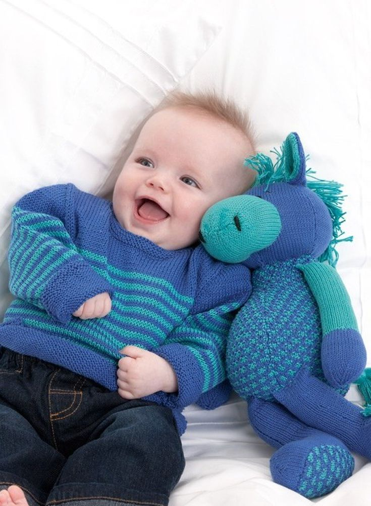 Matching knitted baby toy and cardigan set from Patons - pattern ...