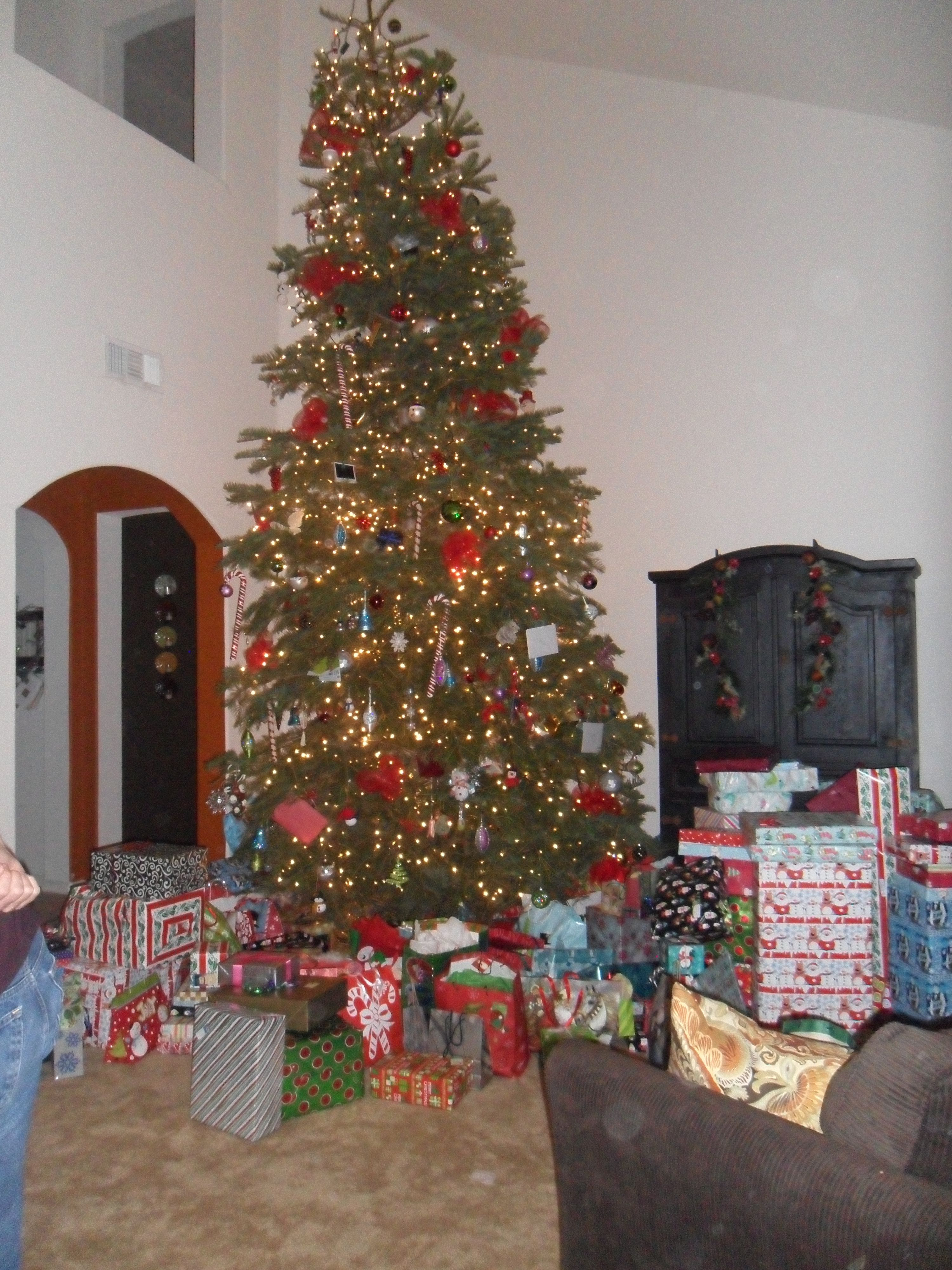 Our tree was so huge this year but what cracks me up is all the presents who has this many presents under one tree!