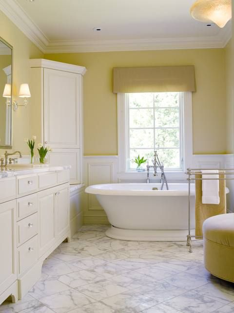 Light Yellow Walls And A White And Grey Tile Bathroom Color