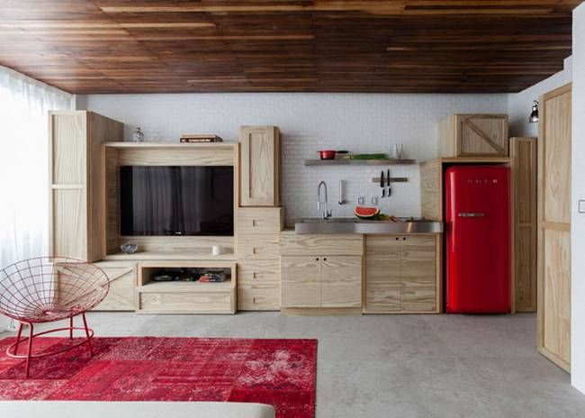 playful wall of storage enlarges this 380 sq. ft. brazilian micro