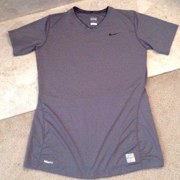 Nike Pro - Tee Shirt Brand New (no tags attached) Nike Pro T Shirt. Grey  with the black Nike  Check  near the shoulder. Fitted and lays flat over  your black ... b47ef43d4